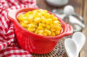 stock photo of sweet-corn  - Canned corn in bowl on a table - JPG