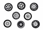 stock photo of alloy  - Collection of wheels or tyres with spoked alloy rims and hubs - JPG