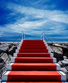 pic of stairway to heaven  - Red carpet stairway leading to heaven with stanchions barriers on both sides - JPG