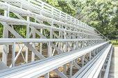 stock photo of grandstand  - white Grandstand Seats outdoor for looking football - JPG