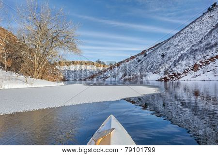 winter canoe paddling on Horsetooth Reservoir near Fort Collins in northern Colorado