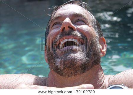 smiling mature man in pool
