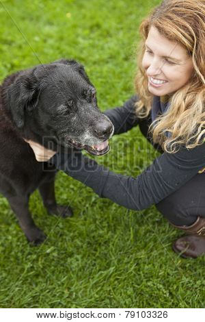 girl and her senior dog