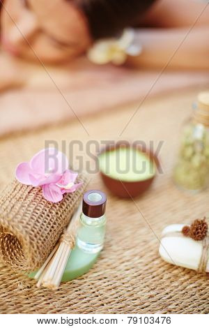 Cosmetic objects with relaxed female on background