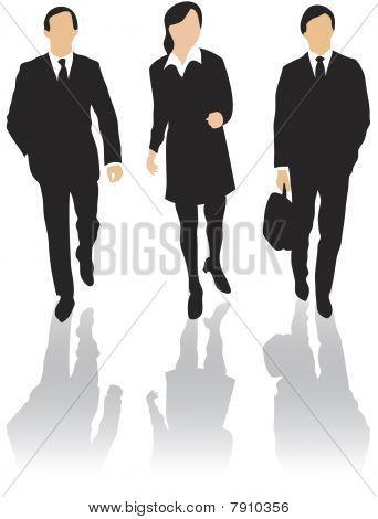 Three business people walking