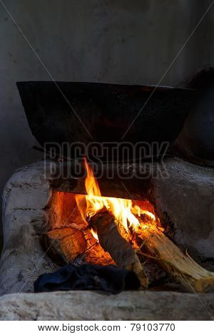Pot Being Cooked In Traditional Fire