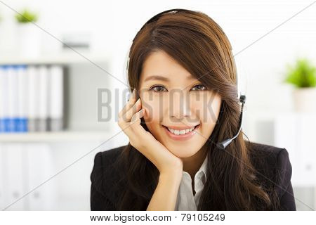 Young Beautiful Business Woman In Headset