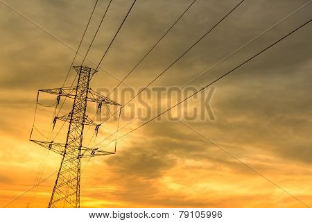 High-voltage Tower With Sunset Sky.