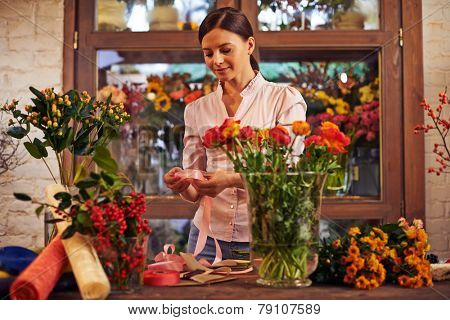 Flower girl working with flowers