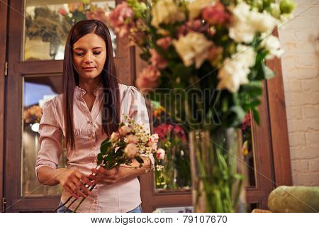 Young woman working at flower shop