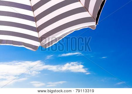 High Resolution Beach Umbrella On Blue Sky Background