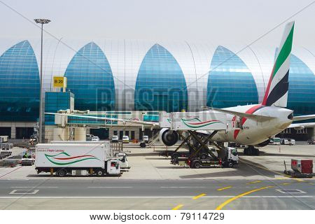 DUBAI - APRIL 23: Dubai International Airport on April 23, 2013 in Dubai, UAE. Emirates handles major part of passenger traffic and aircraft movements at the airport.
