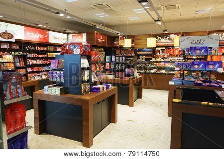 GENEVA - SEP 16: chocolate shop in airport on September 16, 2014 in Geneva, Switzerland. Geneva International Airport is the international airport of Geneva, Switzerland.