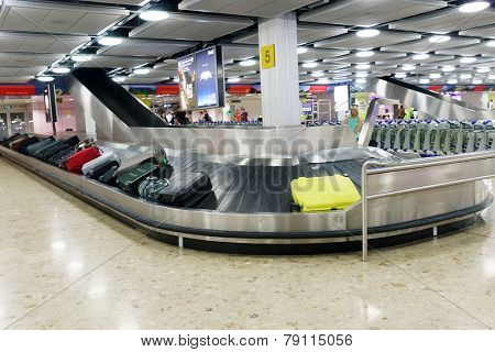GENEVA - SEP 15: Baggage claim area on September 15, 2014 in Geneva, Switzerland. Geneva International Airport is the international airport of Geneva, Switzerland