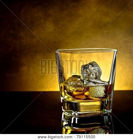 Whiskey Glass With Ice And Warm Light And Black Table, Warm Atmosphere
