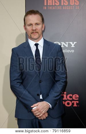 NEW YORK-AUG 26: Director Morgan Spurlock (L) and guest attend the New York premiere of 'One Direction: This Is Us' at the Ziegfeld Theater on August 26, 2013 in New York City.