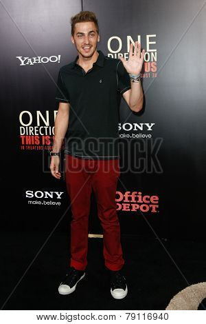 NEW YORK-AUG 26: Singer Kendall Schmidt of Big Time Rush attends the New York premiere of 'One Direction: This Is Us' at the Ziegfeld Theater on August 26, 2013 in New York City.