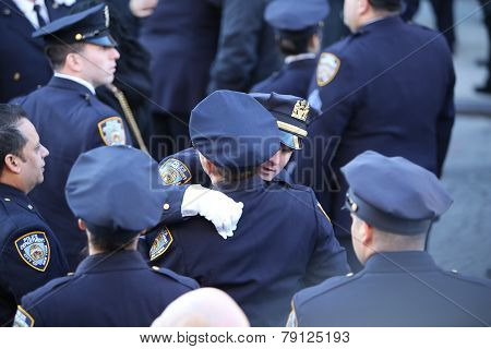 NYPD officers embrace outside church