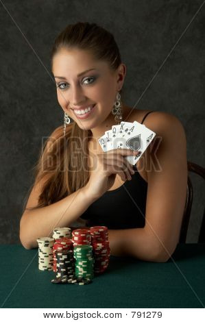 Beautiful Young Woman Holding a Royal Flush
