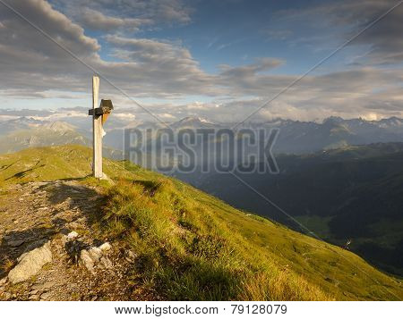 Summit cross on the mountain peak
