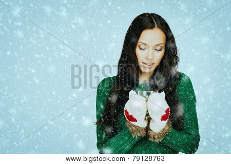 Brunette with hot drink in snow