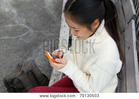 Smiling Woman Sending Text Message