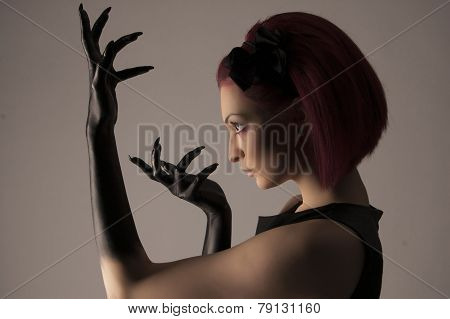 Beautiful Woman With Red Hair And Black Paint On Hands