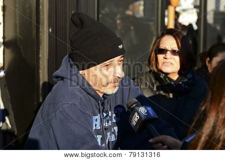 Queens resident interviewed by press
