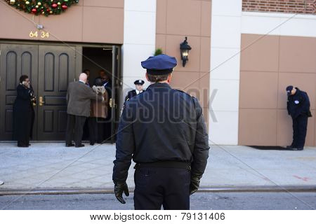 NYPD officer in front of church