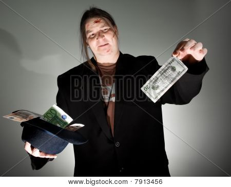Man Holding 20 Dollars In Abomination
