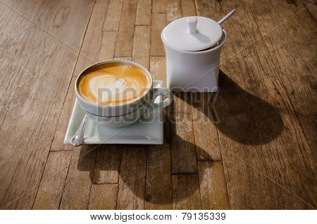 Cup Of Cappucchino Over Wooden Table