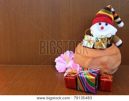 Santa Claus And Giftbox In Pottery to