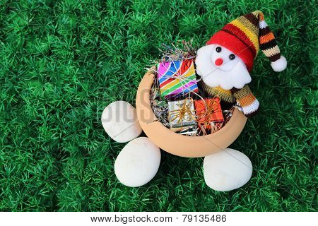 Santa Claus And Giftbox In Pottery