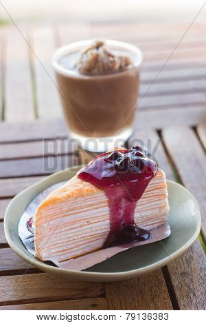 Crepe Cake With Blueberries Sauce And Chocolate Frappe