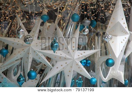 Pretty holiday decorations hanging in window