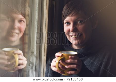 Beautiful Woman Drinking Coffee In Dark Room