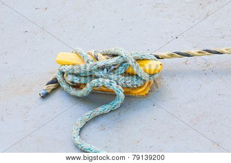 Blue Frayed Rope On Yellow Cleat