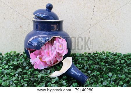 Artificial Flowers In The Broken Tea Pot