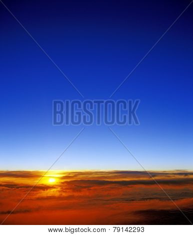 Sunset Over A Clouds.