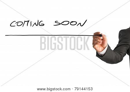 Man Writing Coming Soon On A Virtual Screen