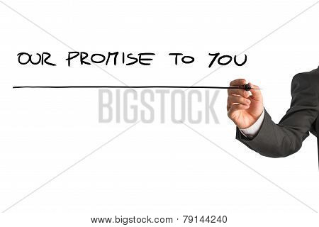 Hand Of A Man Writing Our Promise To You On A Virtual Screen