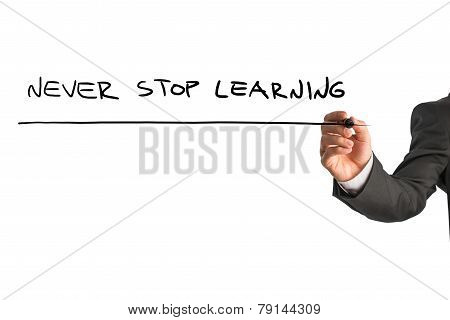 Businessman Writing - Never Stop Learning
