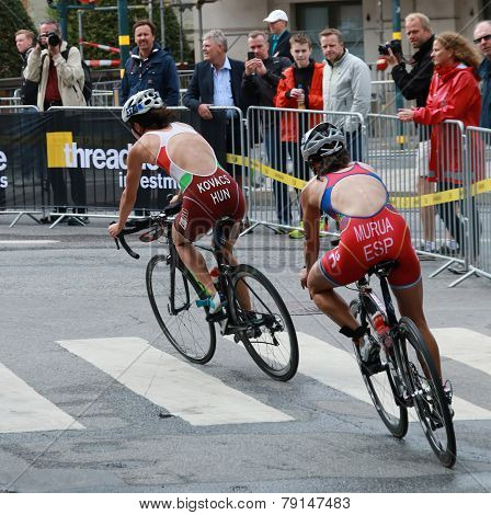 Kovacs And Murua Cycling In The Triathlon Event