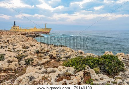 Ship Aground Near Rocky Coast