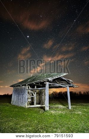 Shack On A Meadow At Night