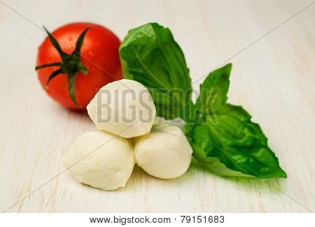 Ingredients For Caprese : Mozzarella , Cherry Tomatoes And Basil