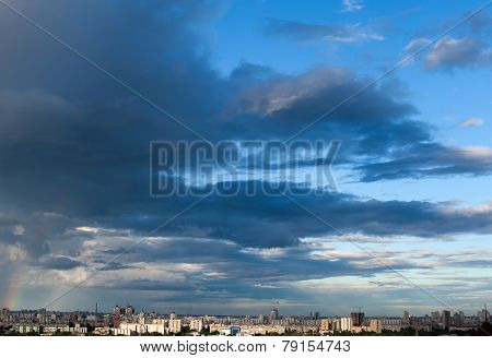 A stormy afternoon cloudscape over a city