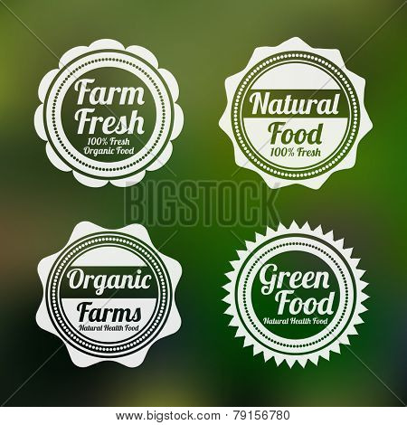 Set of four badges of farm fresh, natural food, organic farms and green food shop on shiny green background.