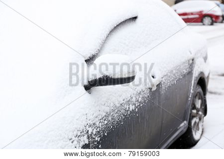 Car covered with snow, outdoors