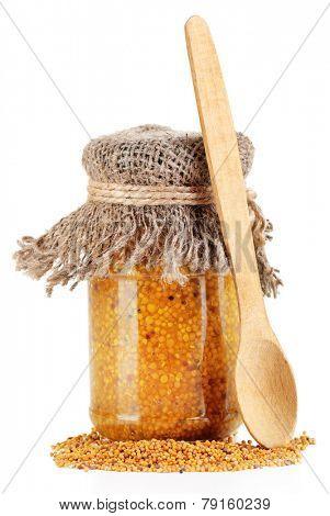Dijon Mustard in glass jar isolated on white